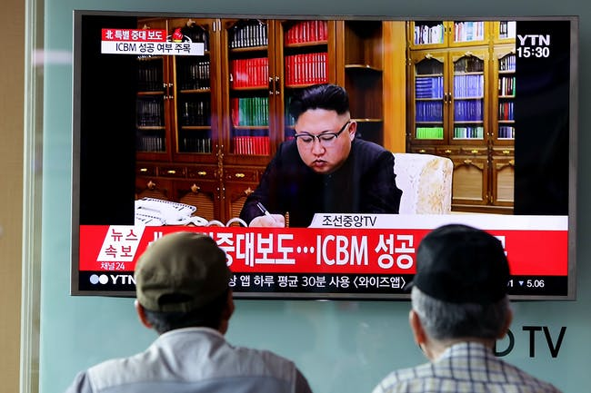 SEOUL, SOUTH KOREA - JULY 04: People watch a North Korea's KRT television show as a presenter announces North Korea has test-launched its first intercontinental ballistic missile at the Seoul Railway Station on July 4, 2017 in Seoul, South Korea. North Korea fired an unidentified ballistic missile on Tuesday from a location near the North's border with China into waters at Japan's exclusive economic zone, east of the Korean Peninsula, according to reports. The latest launch have drawn strong criticism from the U.S. and came ahead of a summit of leaders from the Group of 20 countries in Germany later this week. (Photo by Chung Sung-Jun/Getty Images)