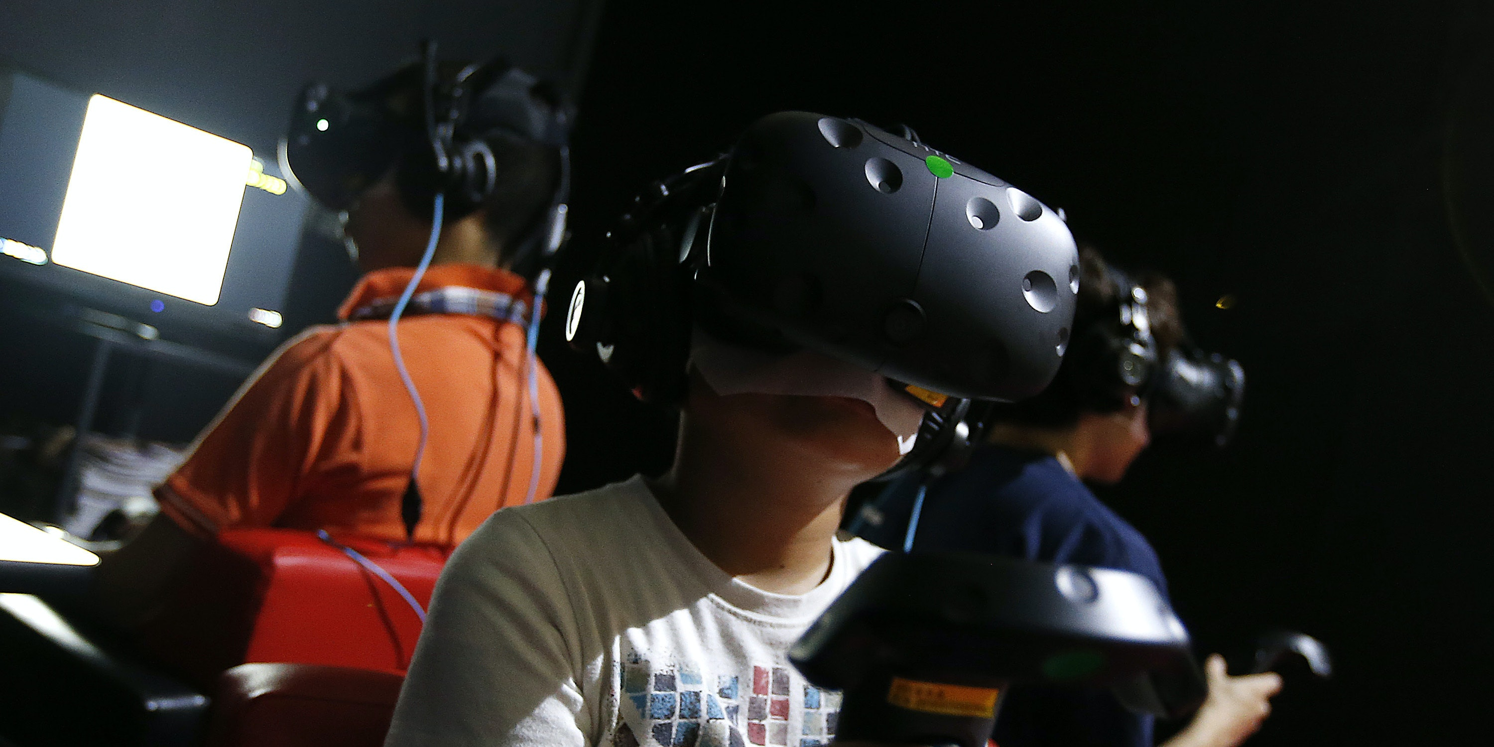 CHIBA, JAPAN - SEPTEMBER 17:  Visitors wearing an HTC Corp. Vive VR headset read Manga in the Square Enix Co. booth at Tokyo Game Show on September 17, 2016 in Chiba, Japan. Tokyo Game Show 2016 is held from September 15 to September 18, 2016.  (Photo by Yuya Shino/Getty Images for TOKYO GAME SHOW)