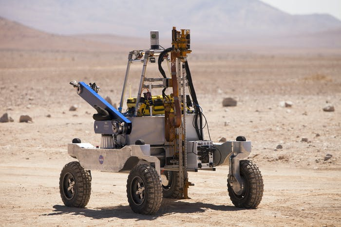 The KREX-2 rover carries a two-meter drill and a robotic sample transfer arm.