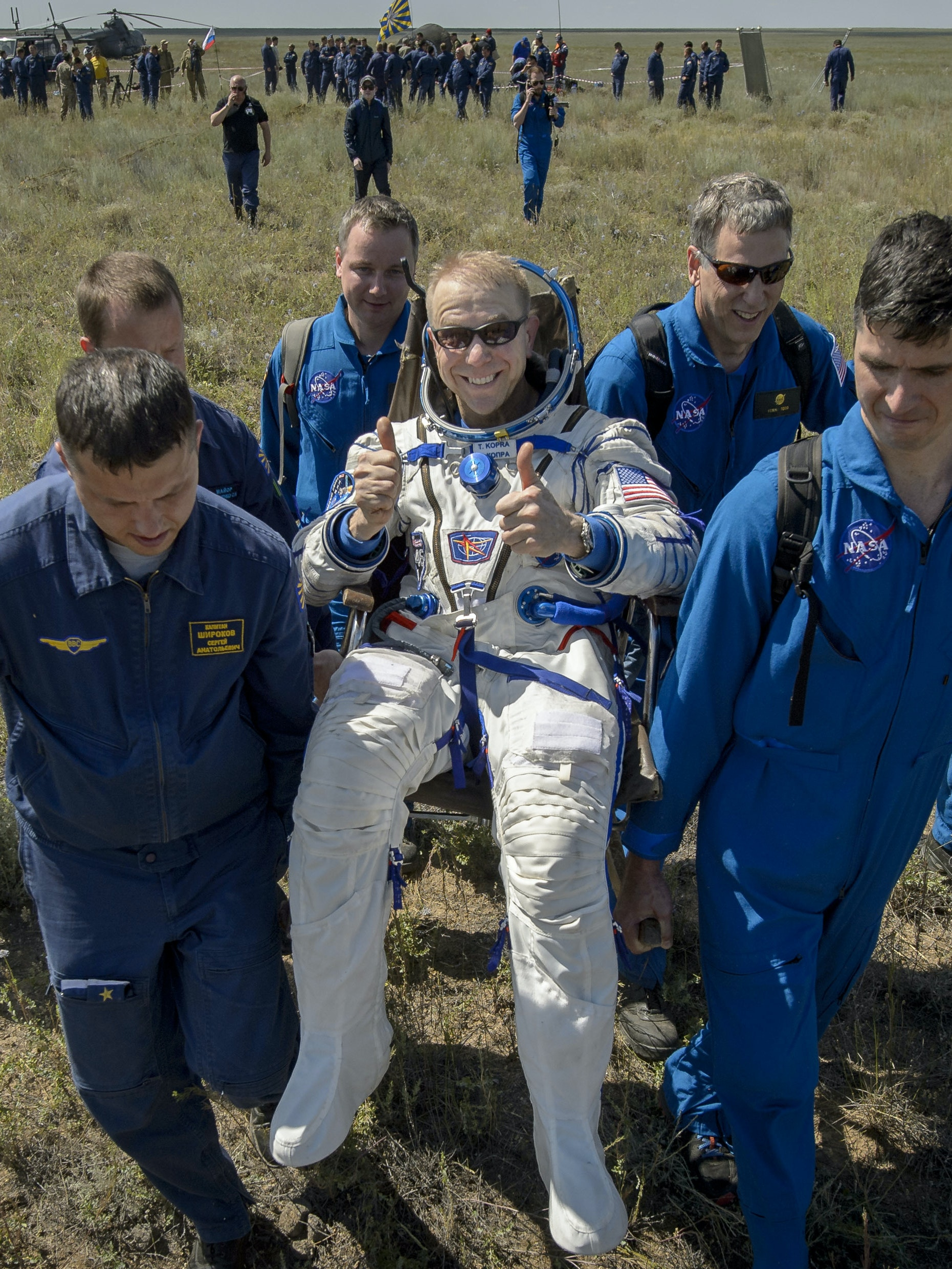Tim Kopra of NASA is carried to a medical tent after he and Yuri Malenchenko of Roscosmos and Tim Peake of the European Space Agency landed in their Soyuz TMA-19M spacecraft in a remote area on June 18, 2016 near the town of Zhezkazgan, Kazakhstan. Kopra, Peake, and Malenchenko are returning after six months in space where they served as members of the Expedition 46 and 47 crews onboard the International Space Station.