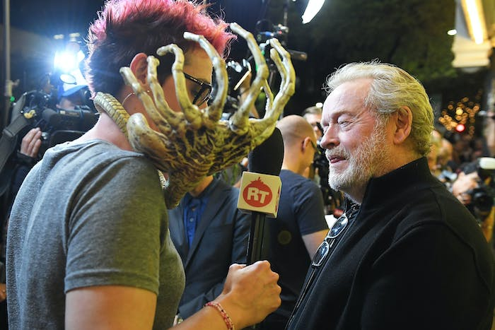 Ridley Scott speaks to someone who is being attacked by an alien.