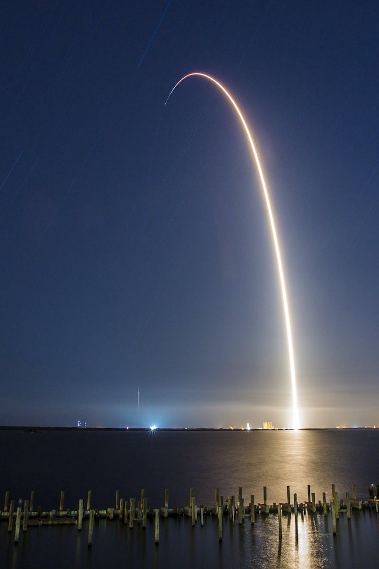 SpaceX's Merah Putih rocket taking off.