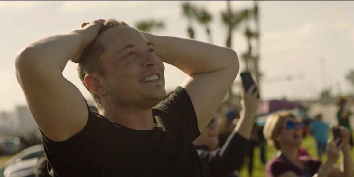Elon Musk watching Falcon Heavy rise