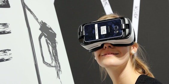 FRANKFURT AM MAIN, GERMANY - OCTOBER 20:  A visitor experienced a fantastic world with VR glasses the 2016 Frankfurt Book Fair (Frankfurter Buchmesse) on October 20, 2016 in Frankfurt am Main, Germany. The 2016 fair, which is among the world's largest book fairs, will be open to the public from October 19-23.  (Photo by Hannelore Foerster/Getty Images)