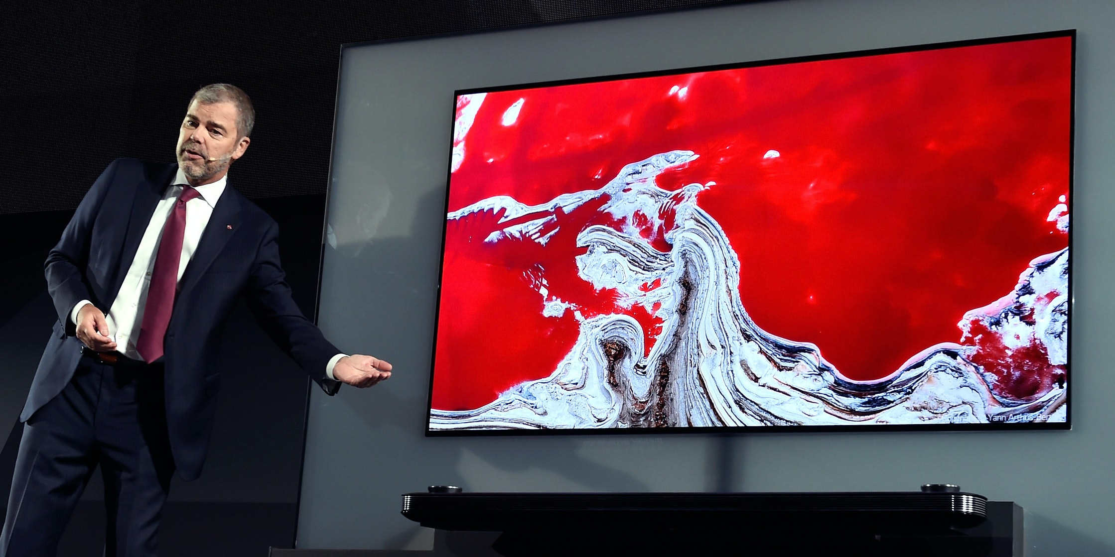 LAS VEGAS, NV - JANUARY 04:  LG Electronics USA Vice President of Marketing David VanderWaal displays the LG Signature OLED TV W during a LG press event for CES 2017 at the Mandalay Bay Convention Center on January 4, 2017 in Las Vegas, Nevada. CES, the world's largest annual consumer technology trade show, runs from January 5-8 and is expected to feature 3,800 exhibitors showing off their latest products and services to more than 165,000 attendees.  (Photo by David Becker/Getty Images)