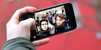 The Syrian refugee Anas Modamani takes a selfi photo with his smartphone after the court session over his lawsuit against Facebook at the Landgericht courthouse on February 6, 2017 in Wurzburg, Germany. Modamani is suing Facebook over selfie photos of himself with German Chancellor Angela Merkel that he says were misused by Facebook users accusing him of being a terrorist or guilty of other crimes and that Facebook refused to remove. This is the first time Facebook is being taken to court in Germany.