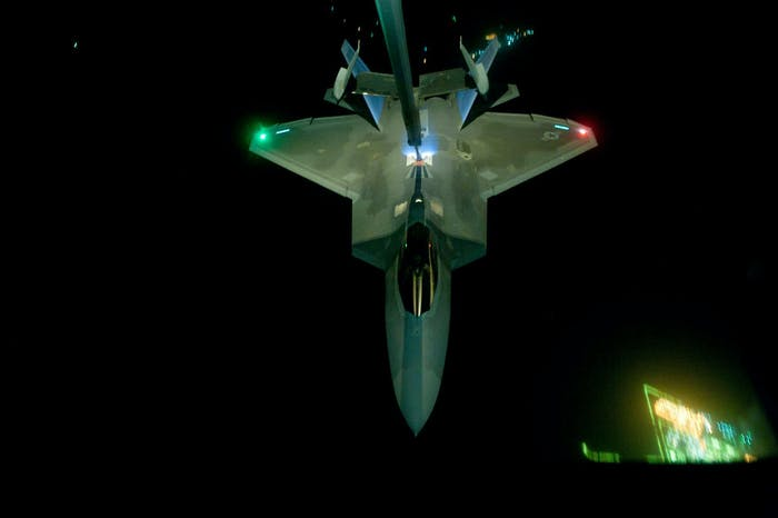 IN FLIGHT - SEPTEMBER 26:  In this handout image provided by the U.S. Air Force, A KC-10 Extender refuels an F-22 Raptor fighter aircraft prior to strike operations in Syria, during flight on September 26, 2014. These aircraft were part of a strike package that was engaging ISIL targets in Syria. (Photo by Tech. Sgt. Russ Scalf/U.S. Air Force via Getty Images)