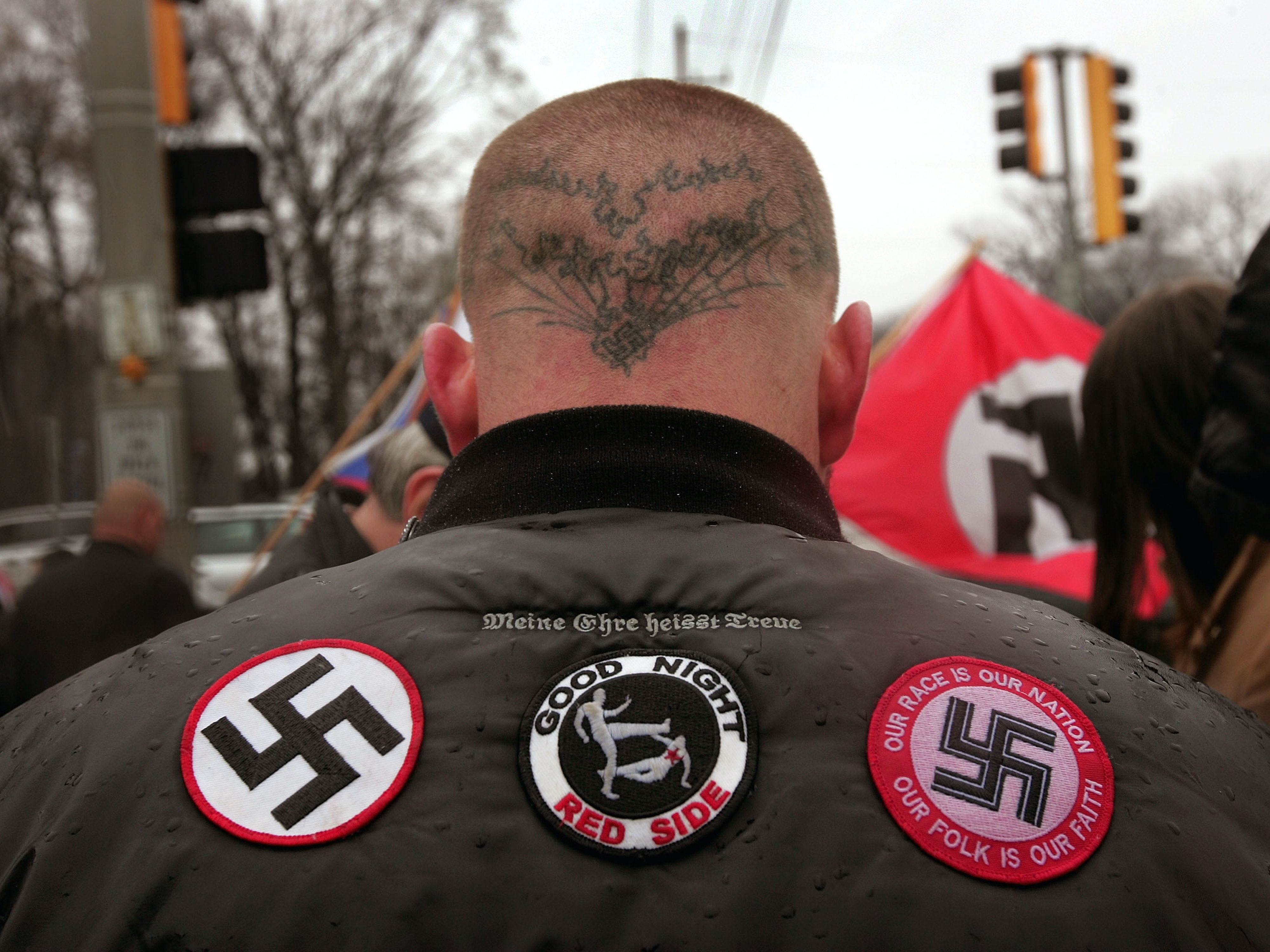 Neo-Nazi protestors organized by the National Socialist Movement demonstrate near where the grand opening ceremonies were held for the Illinois Holocaust Museum & Education Center April 19, 2009, in Skokie, Illinois. About 20 protestors greeted those who left the event with white power salutes and chants.