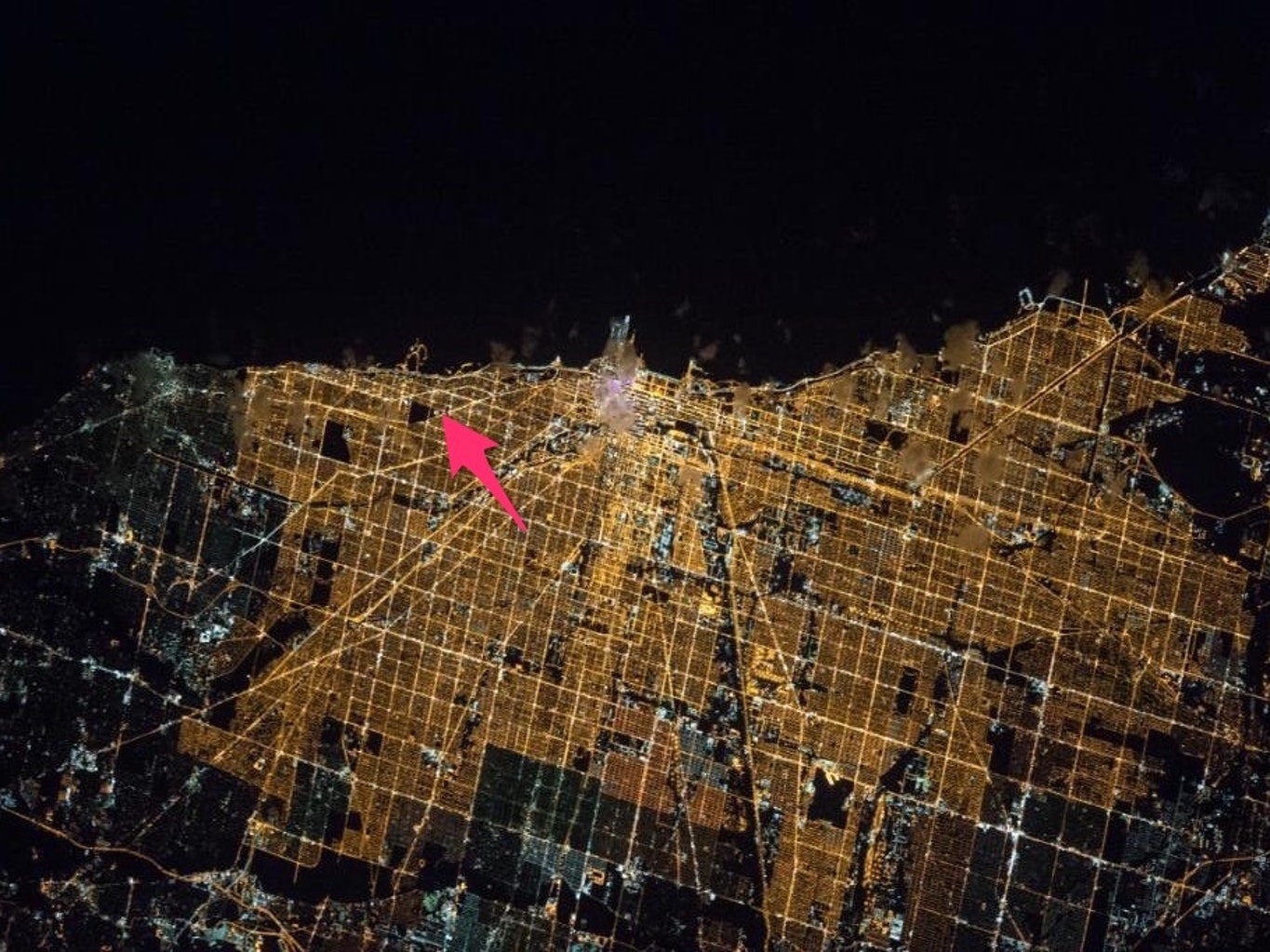 Note: NASA presented its view of Chicago-from-space horizontally. The blackness at the top is Lake Michigan, which makes the city's eastern -- not, northern, as you see here -- border.