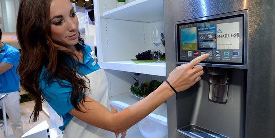 LAS VEGAS, NV - JANUARY 07:  Samsung spokesmodel Kai Madden displays the connectivity feature on a Samsung smart refrigerator at the 2014 International CES at the Las Vegas Convention Center on January 7, 2014 in Las Vegas, Nevada. CES, the world's largest annual consumer technology trade show, runs through January 10 and is expected to feature 3,200 exhibitors showing off their latest products and services to about 150,000 attendees.  (Photo by David Becker/Getty Images)