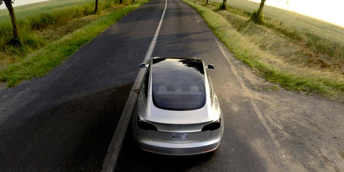 The Tesla Model 3 out on the road.