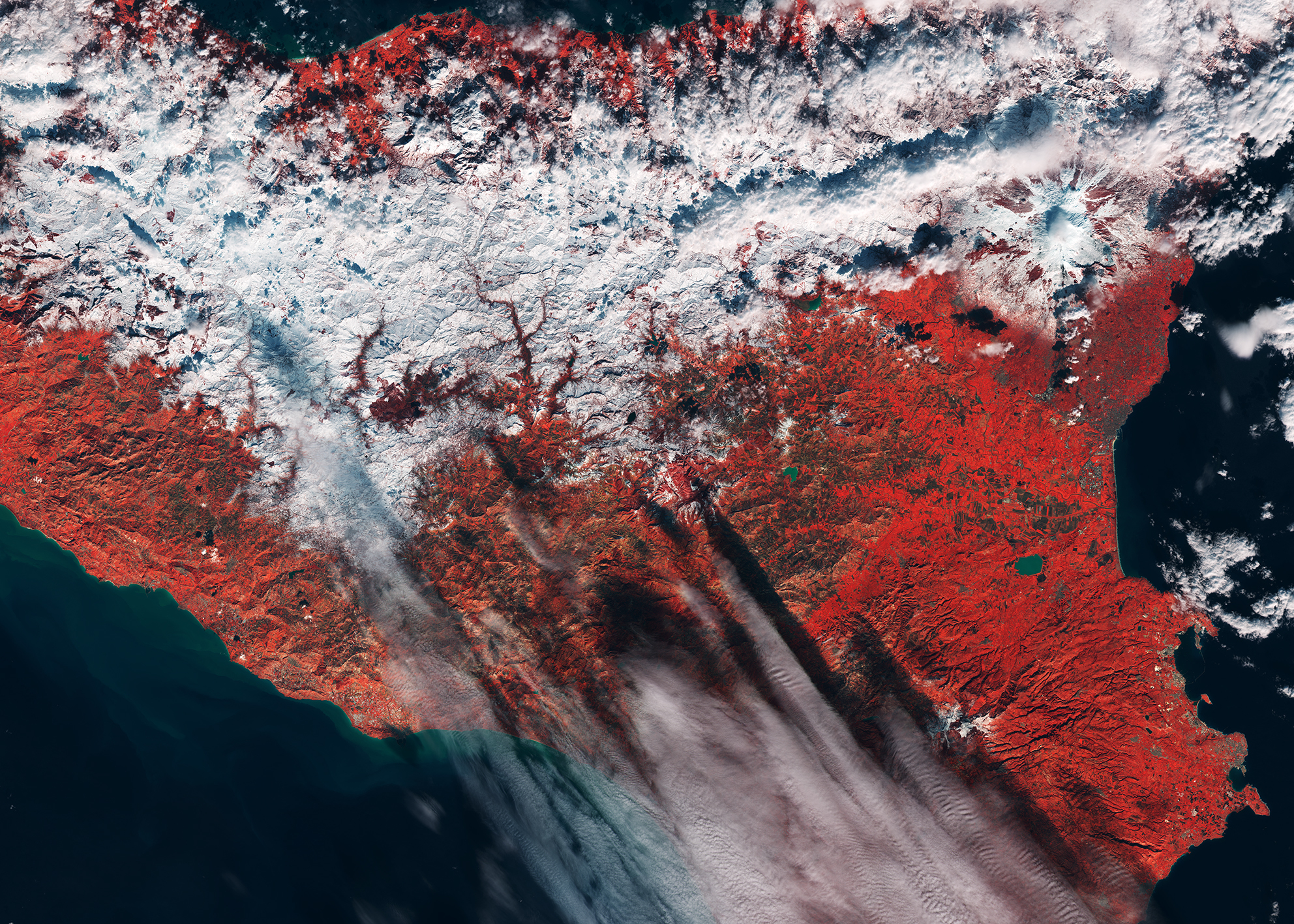 This photo from Copernicus Sentinel-2A shows snow in Sicily, with vegetation appearing red.