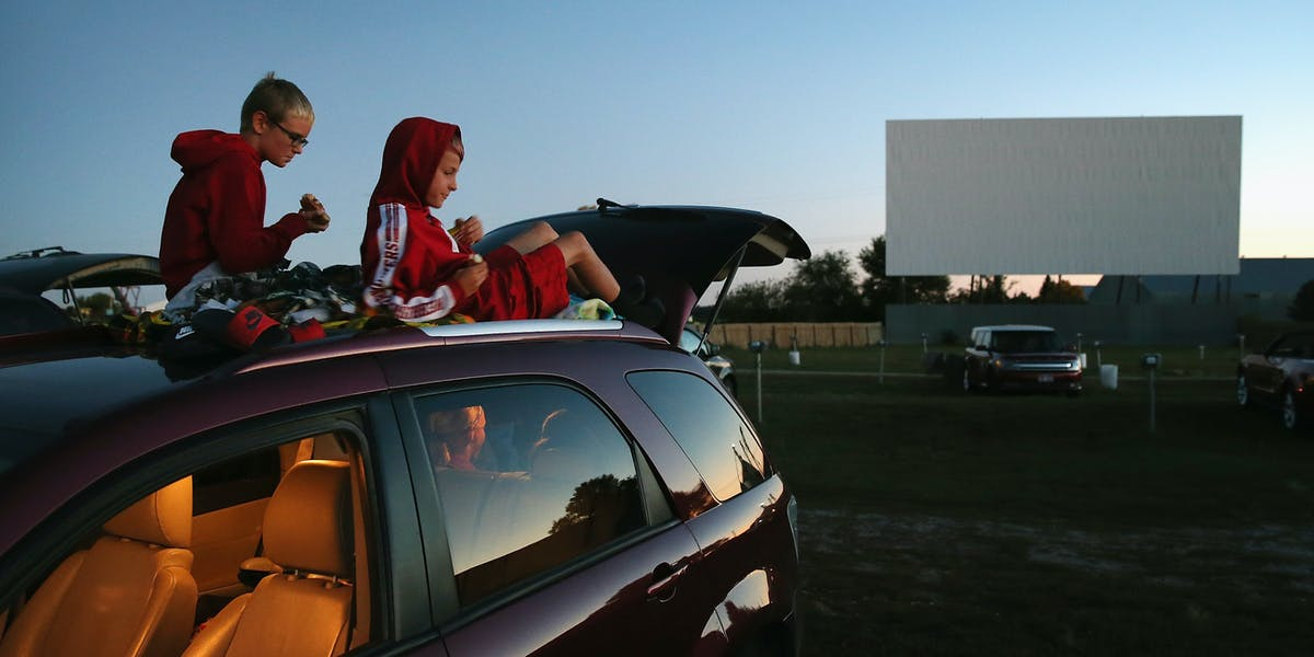 Trey Dodds and Cole Hoacek get settled in for the start of a movie at the Starlite Drive-In Theater in Neligh, Nebraska.