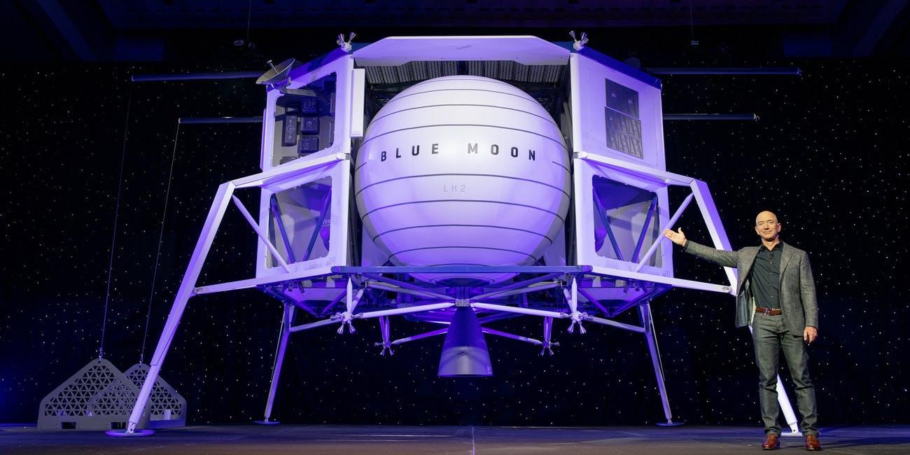 Jeff Bezos next to Blue Moon