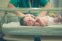 Newborn in a hospital nursery.