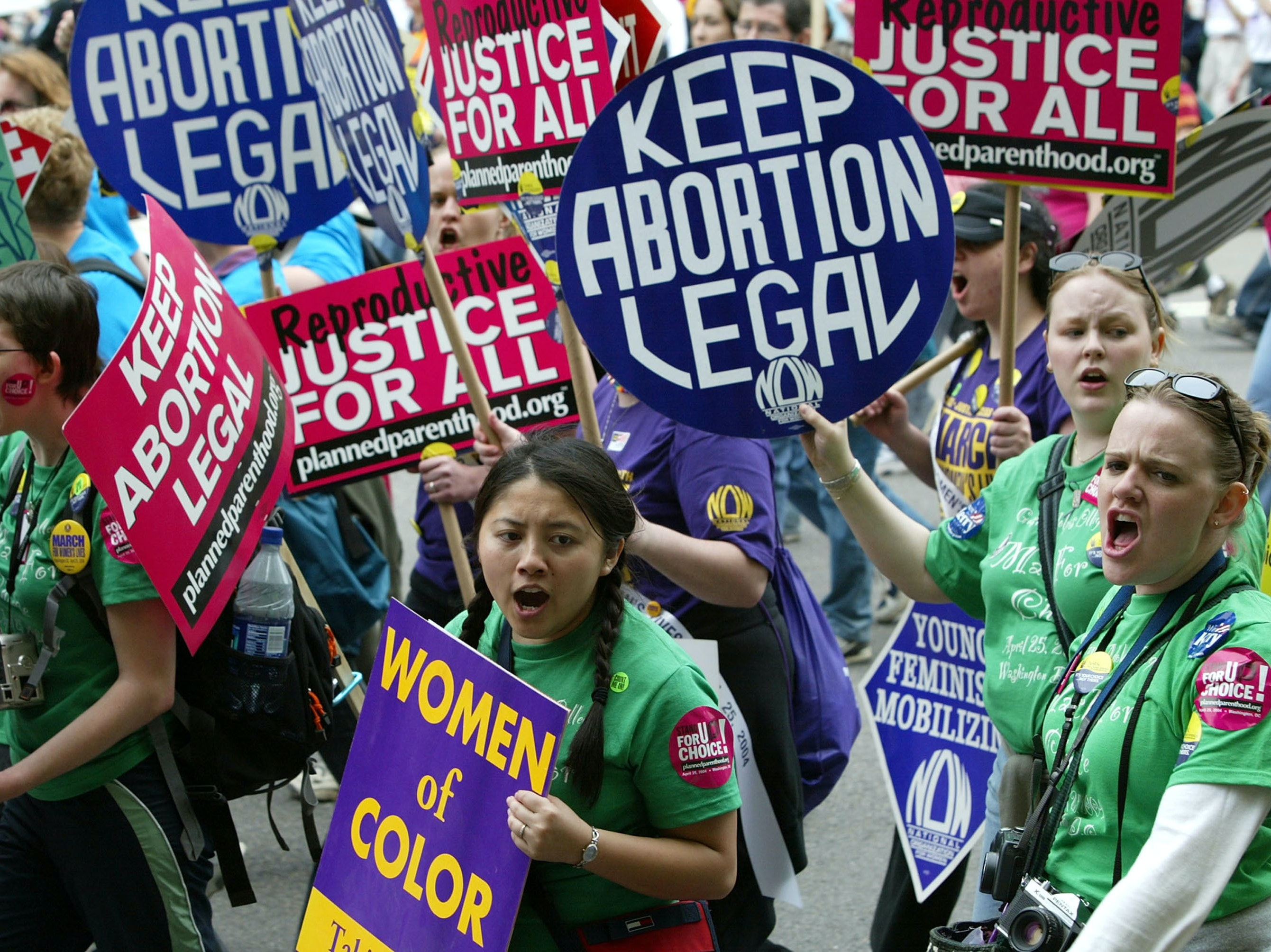 WASHINGTON - APRIL 25:  Pro-choice activists shout slogans as they take part in the March For Women's Lives April 25, 2004 in Washington, DC. Hundreds of thousands of activist demonstrated for abortion rights and opposition to the Bush Administration's policies on reproductive health issues.  (Photo by Alex Wong/Getty Images)
