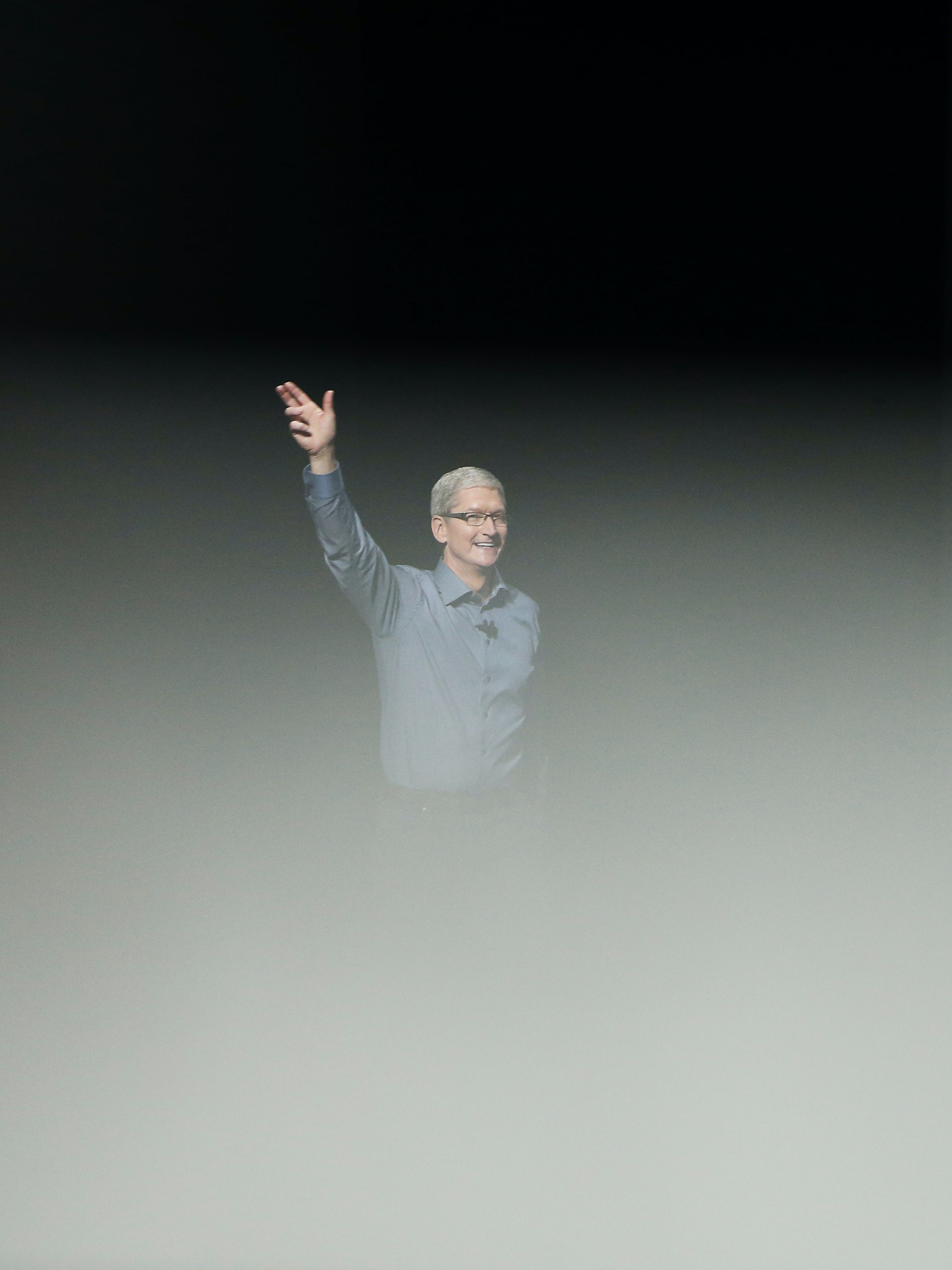 SAN FRANCISCO, CA - SEPTEMBER 9: Tim Cook waves as he arrive on stage during an Apple Special Event on at Bill Graham Civic Auditorium September 9, 2015 in San Francisco, California. Apple Inc. unveiled latest iterations of its smart phone, forecasted to be the 6S and 6S Plus and announced an update to its Apple TV set-top box. (Photo by Stephen Lam/ Getty Images)