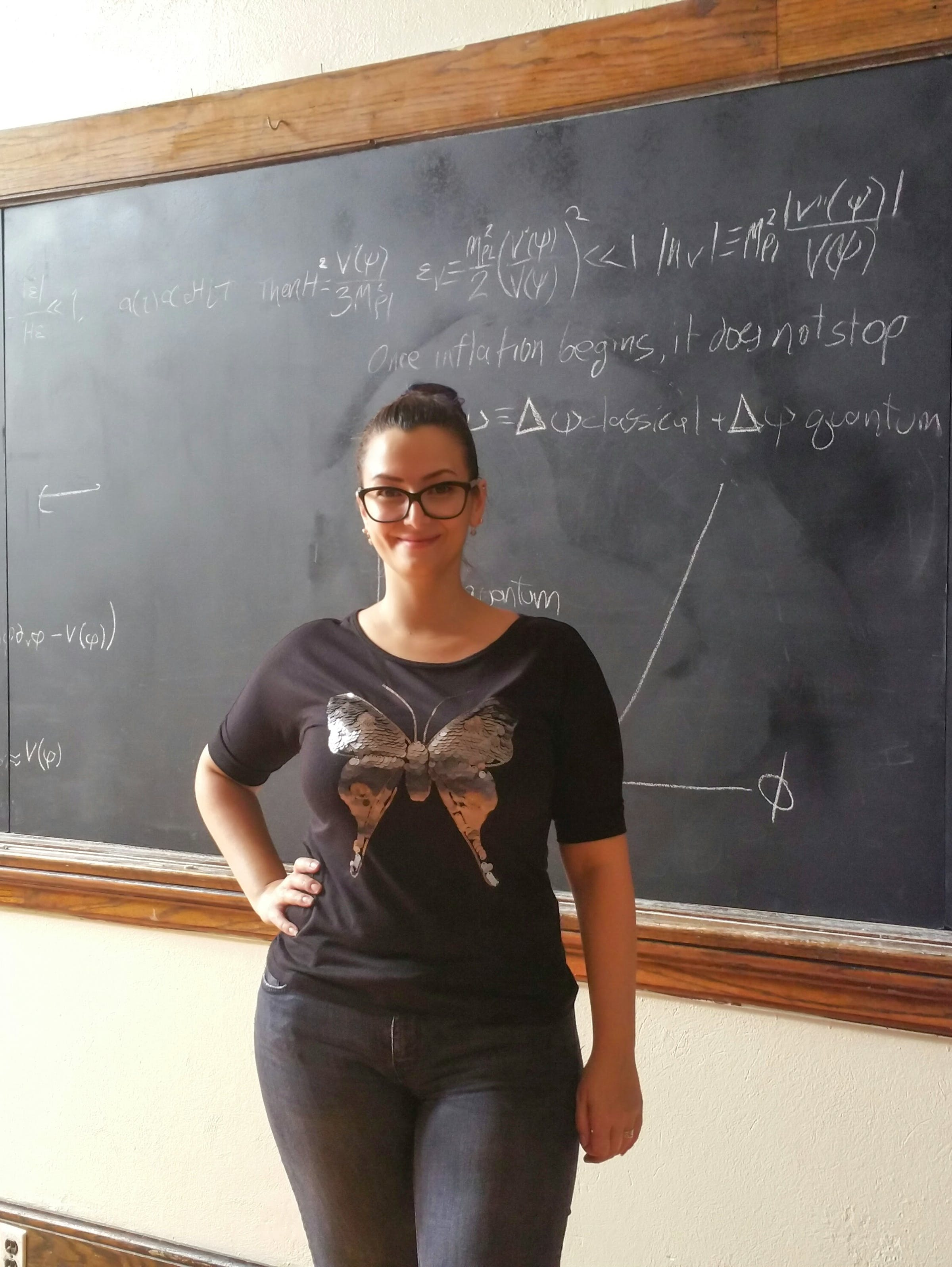 Sophia Nasr on the '12 Monkeys' set, in front of the chalk board with the equations she prepared.