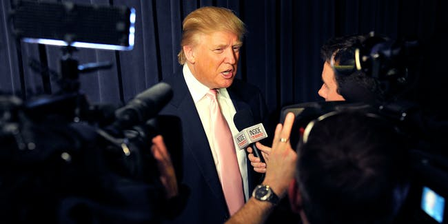 """Donald Trump speaks with reporters during """"An Evening with 'The Celebrity Apprentice' """"at Florence Gould Hall on April 26, 2011."""