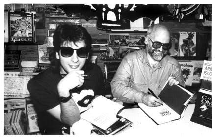 Neil Gaiman and Terry Pratchett sign copies of 'Good Omens'