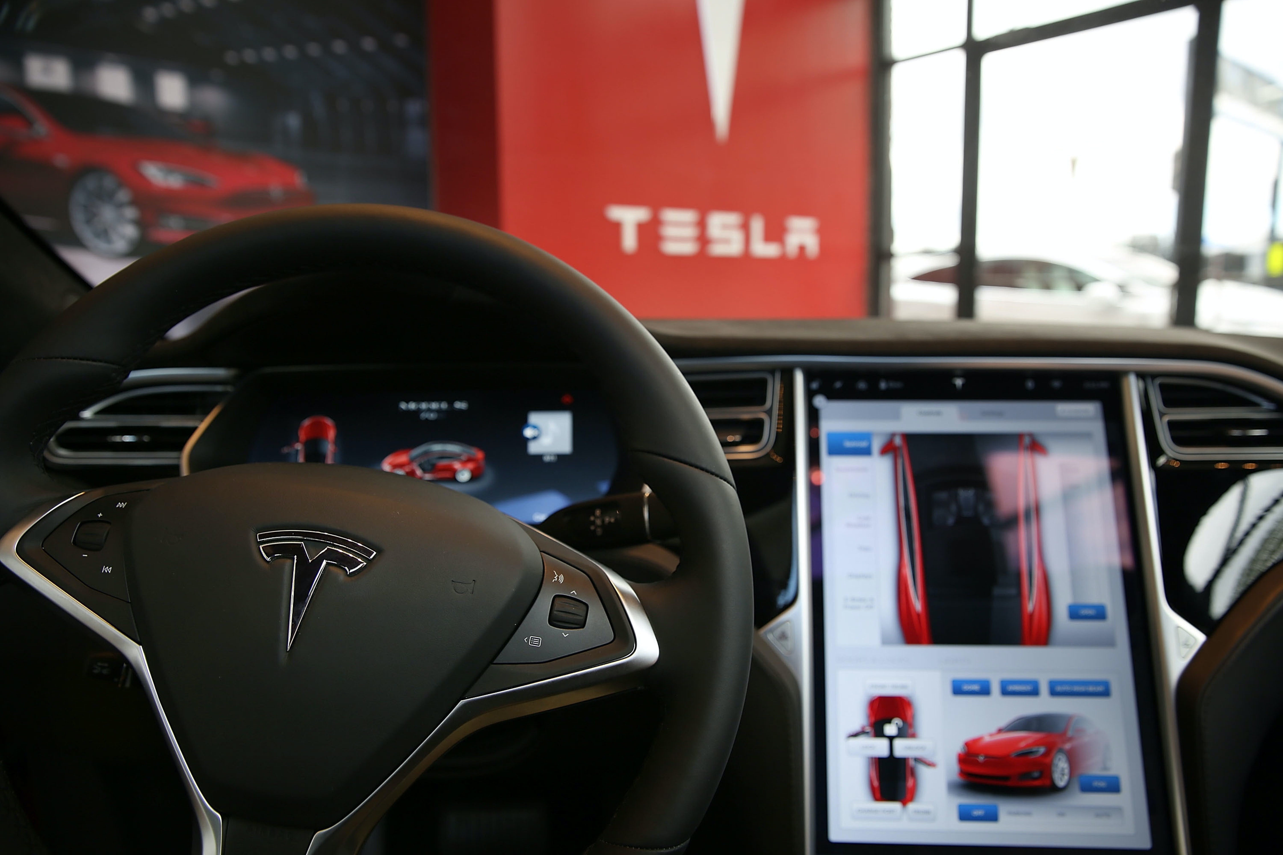 The inside of a Tesla vehicle and its internal heads up display.