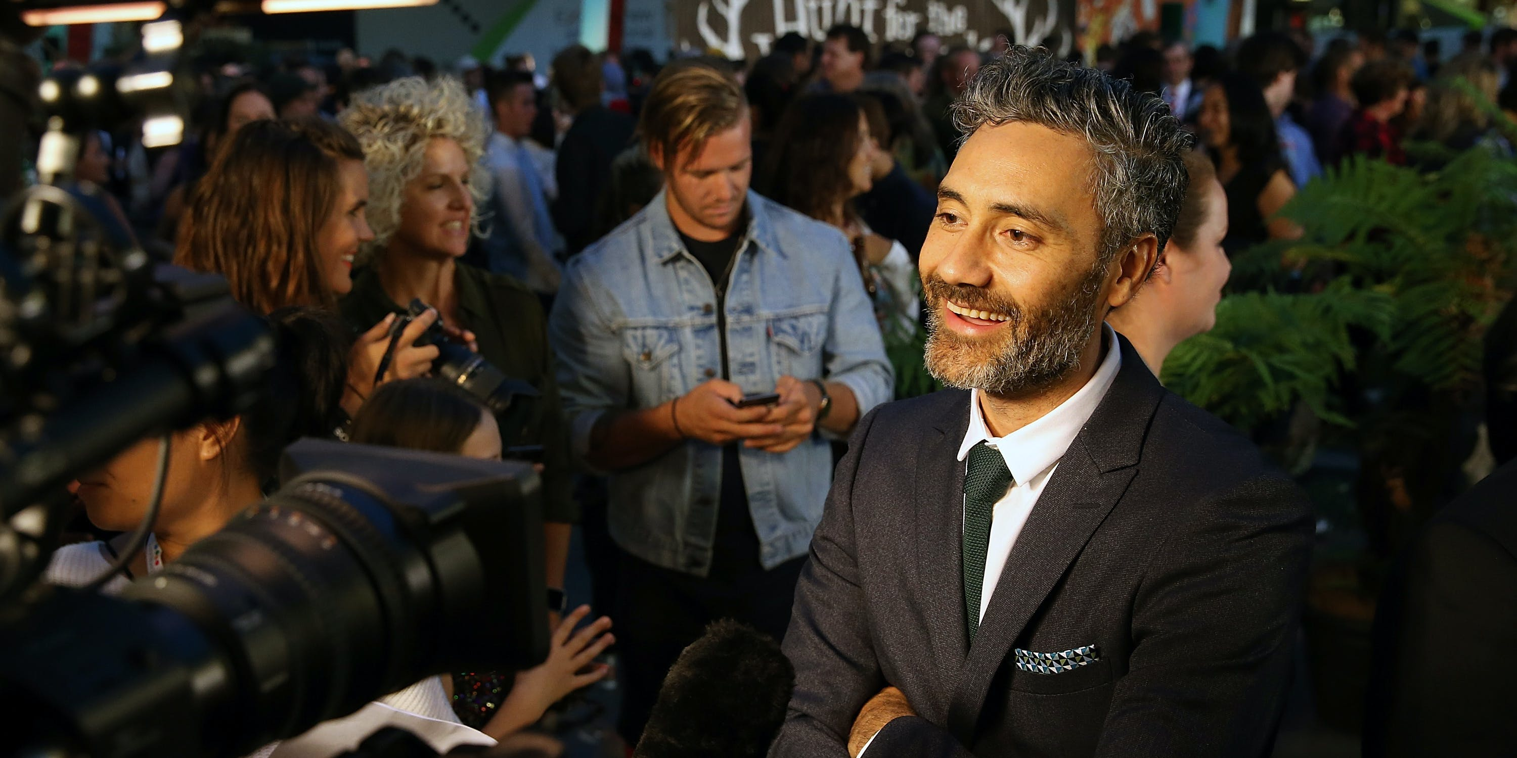 AUCKLAND, NEW ZEALAND - MARCH 30:  Director Taika Waititi speaks to media as he arrives ahead of the New Zealand premiere of Hunt For The Wilderpeople on March 30, 2016 in Auckland, New Zealand.  (Photo by Fiona Goodall/Getty Images)