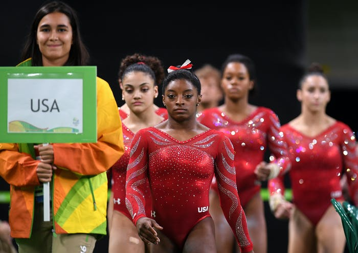 RIO DE JANEIRO, BRAZIL - AUGUST 04:  Simone Biles of the United States leads her team mates during an artistic gymnastics training session on August 4, 2016 at the Arena Olimpica do Rio in Rio de Janeiro, Brazil.  (Photo by Laurence Griffiths/Getty Images)