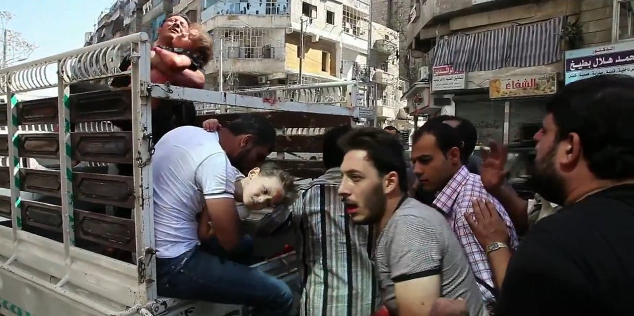 Wounded civilians arrive at a hospital in Aleppo during the Syrian civil war.
