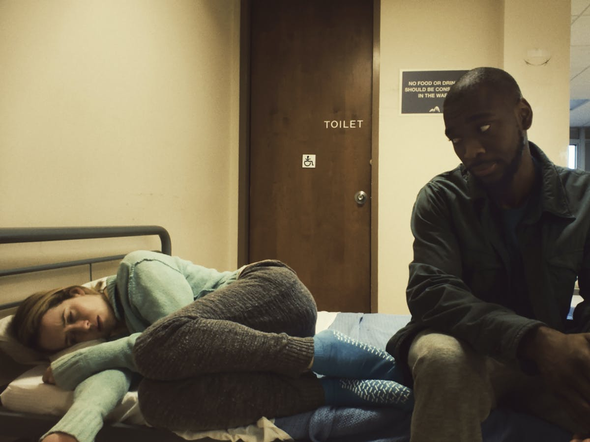 Claire Foy (left) and Jay Pharoah in 'Unsane'