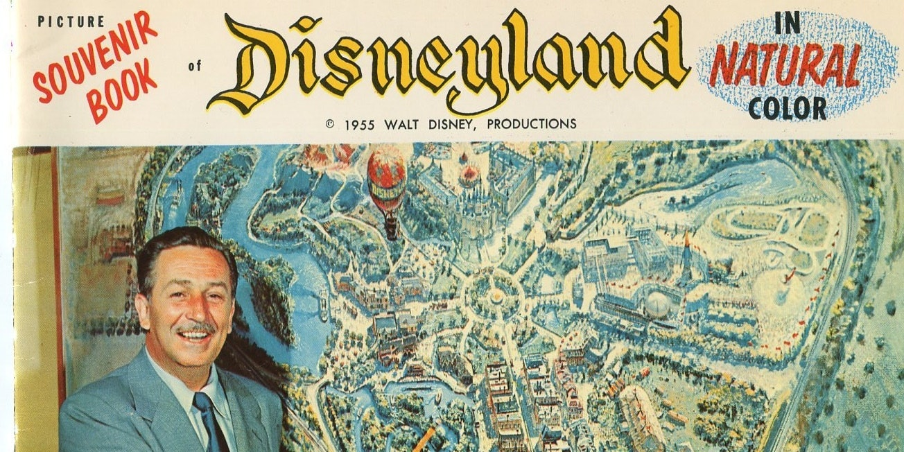 Walt Disney with a map of the original Disneyland