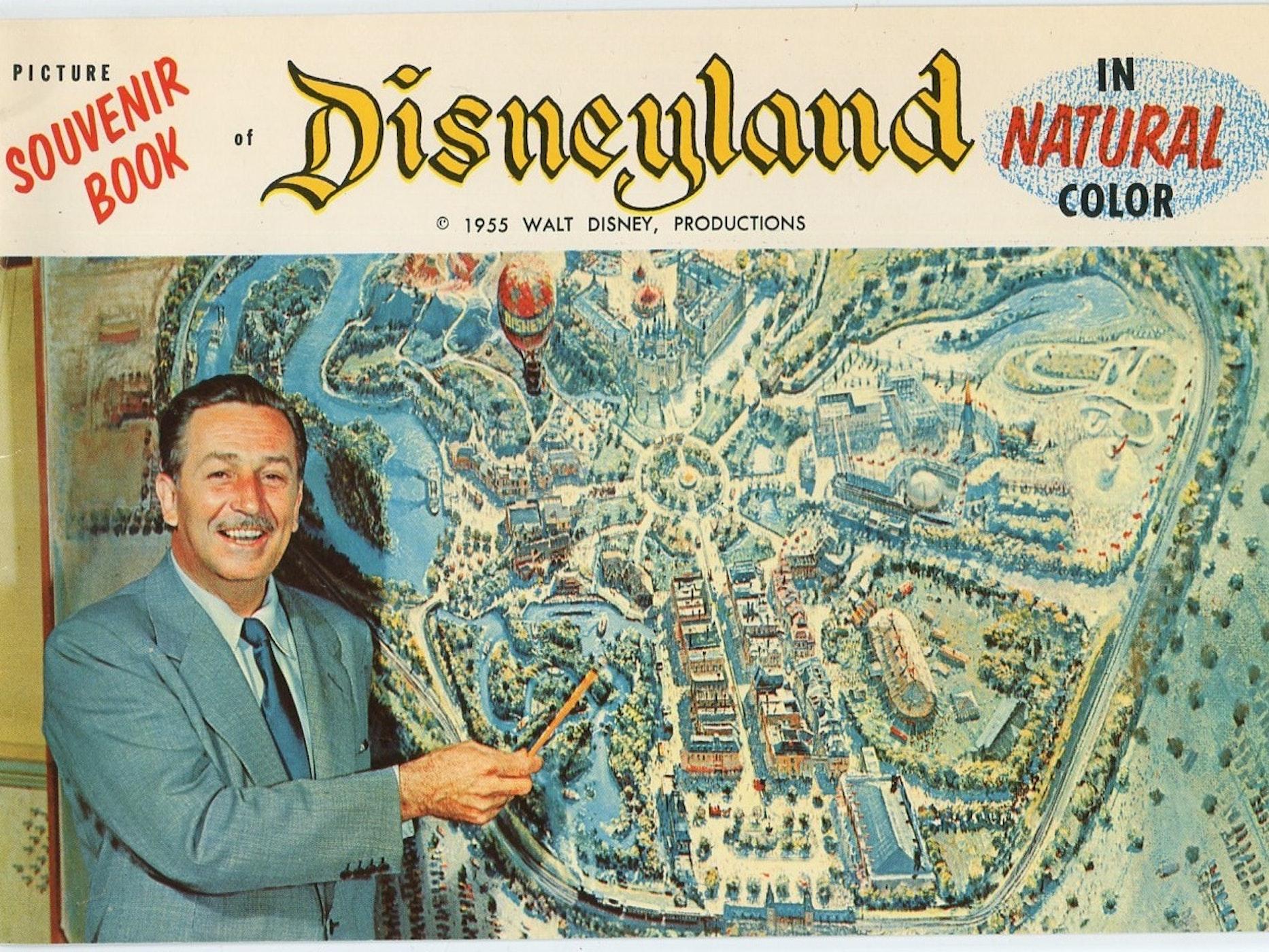 Walt Disney with a map of the original Disneyland