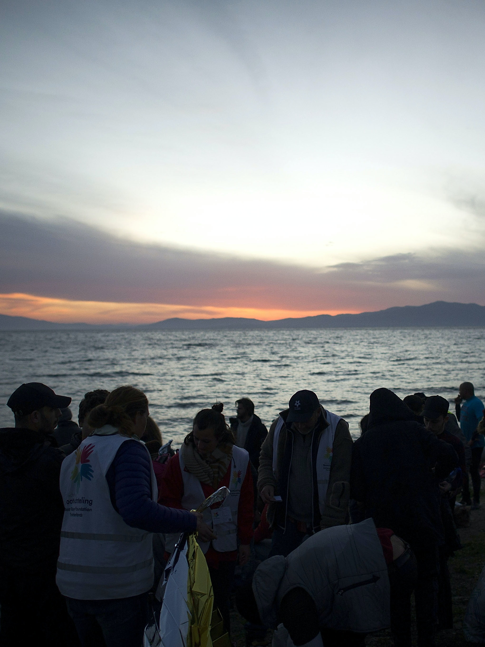 Refugees from mainly Afghanistan and Syria are seen shortly after arriving on an inflatable boat with other refugees, crossing the sea from Turkey to Lesbos, some 5 kilometres south of the capital of the Island, on March 12, 2016 in Mytelene, Greece. Migrants and refugees are still arriving on the shores of the Island of Lesbos, while the multinational force of the Standing NATO (North Atlantic Treaty Organisation) Maritime Group 2 are patrolling the coast of the Greek Island of Lesbos and the Turkish coast. Turkey announced on Monday to take back illegal migrants in exchange for genuine refugees.