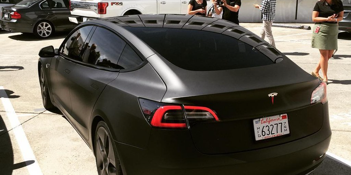 feast your eyes on a murdered out tesla model 3 prowling. Black Bedroom Furniture Sets. Home Design Ideas