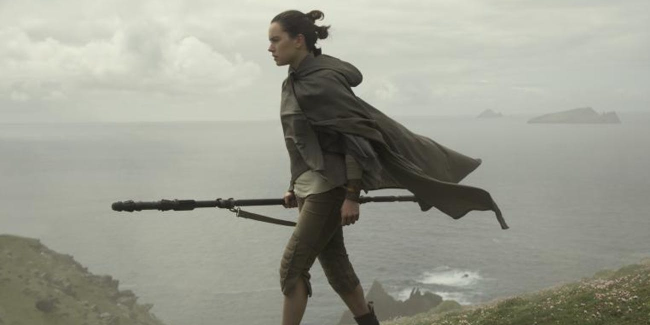 Daisy Ridley as Rey walking on Ahch-To in 'Star Wars: The Last Jedi'