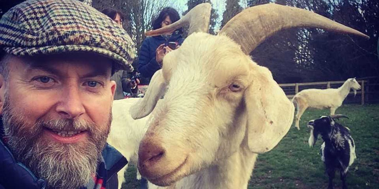 Alan Mcelligott (left) and a goat (right).