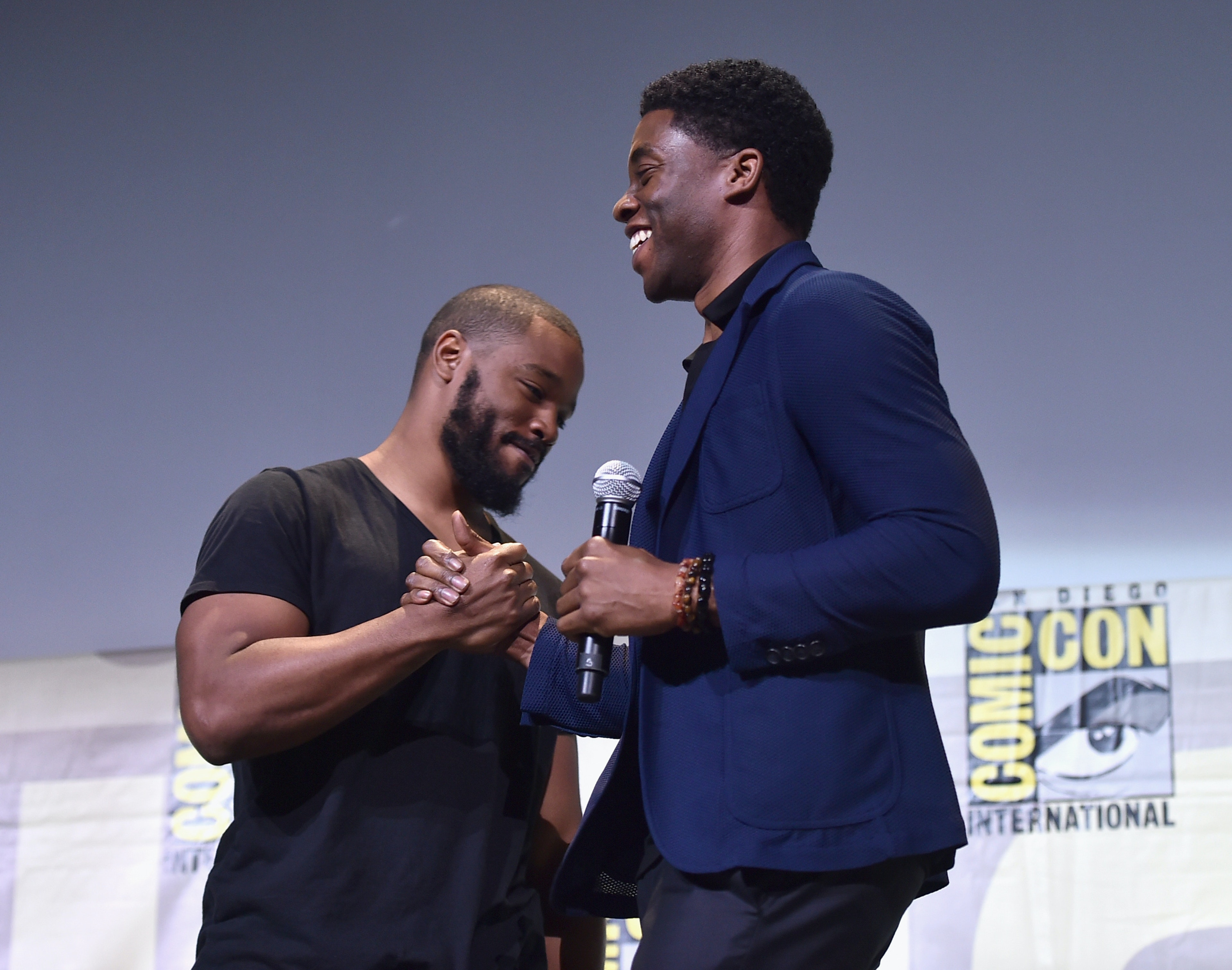 "SAN DIEGO, CA - JULY 23: Director Ryan Coogler (L) and actor Chadwick Boseman from Marvel Studios' 'Black Panther"" attend the San Diego Comic-Con International 2016 Marvel Panel in Hall H on July 23, 2016 in San Diego, California. ©Marvel Studios 2016  (Photo by Alberto E. Rodriguez/Getty Images for Disney)"