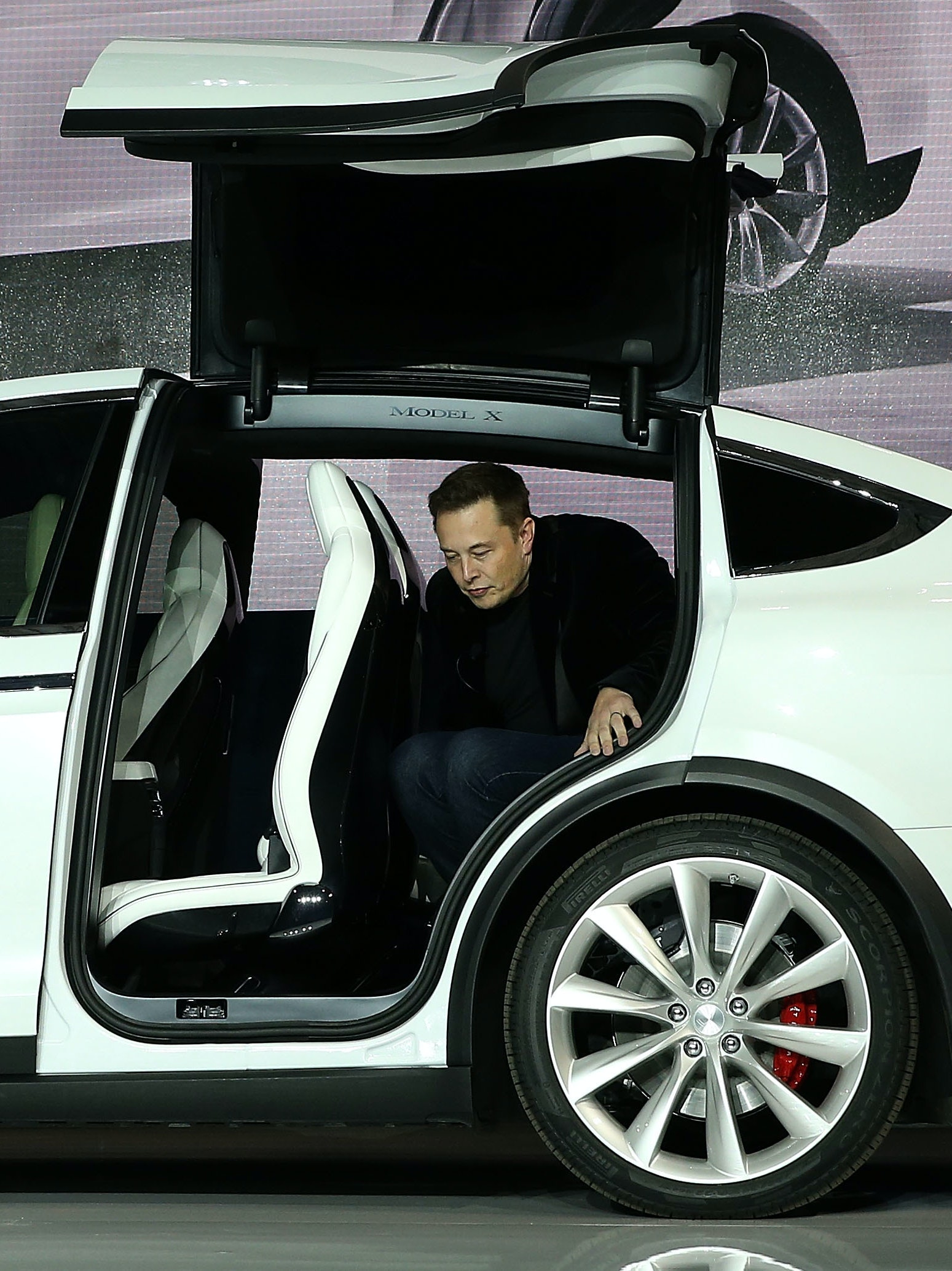 FREMONT, CA - SEPTEMBER 29:  Tesla CEO Elon Musk steps out of the new Tesla Model X during an event to launch the company's new crossover SUV on September 29, 2015 in Fremont, California. After several production delays, Elon Musk officially launched the much anticipated Tesla Model X Crossover SUV. The  (Photo by Justin Sullivan/Getty Images)