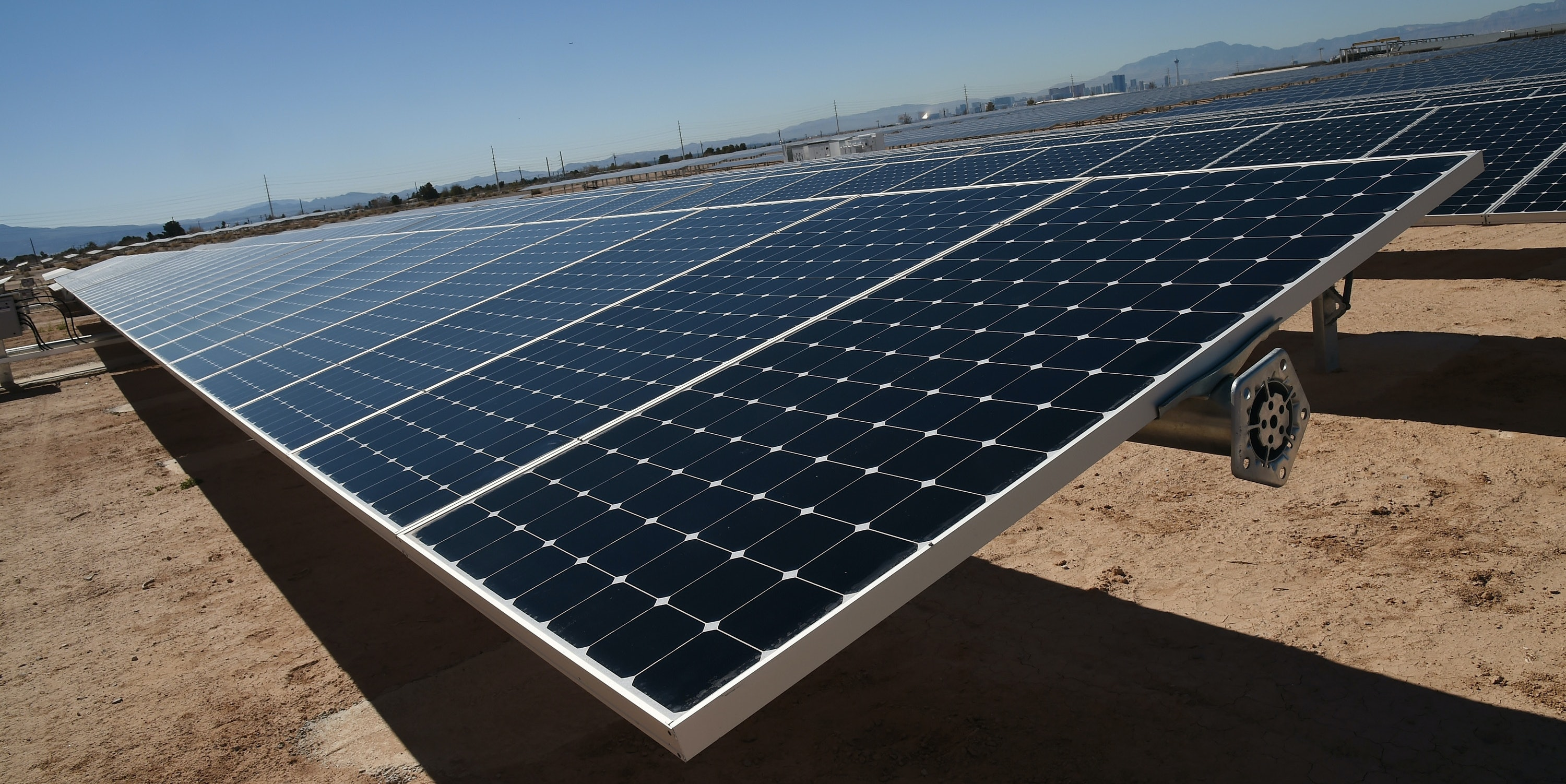 LAS VEGAS, NV - FEBRUARY 16:  Rows of solar panels operate during a dedication ceremony to commemorate the completion of the 102-acre, 15-megawatt Solar Array II Generating Station at Nellis Air Force Base on February 16, 2016 in Las Vegas, Nevada. When coupled with the 13.2-megawatt Nellis Solar Star project completed in 2007, Nellis has the largest solar photovoltaic system in the Department of Defense. During daylight hours the two solar fields combined provide almost all of the base's energy needs or about 42 percent of its overall electricity requirements. Power from the array that is not used will go to the NV Energy grid and back into the local community.  (Photo by Ethan Miller/Getty Images)