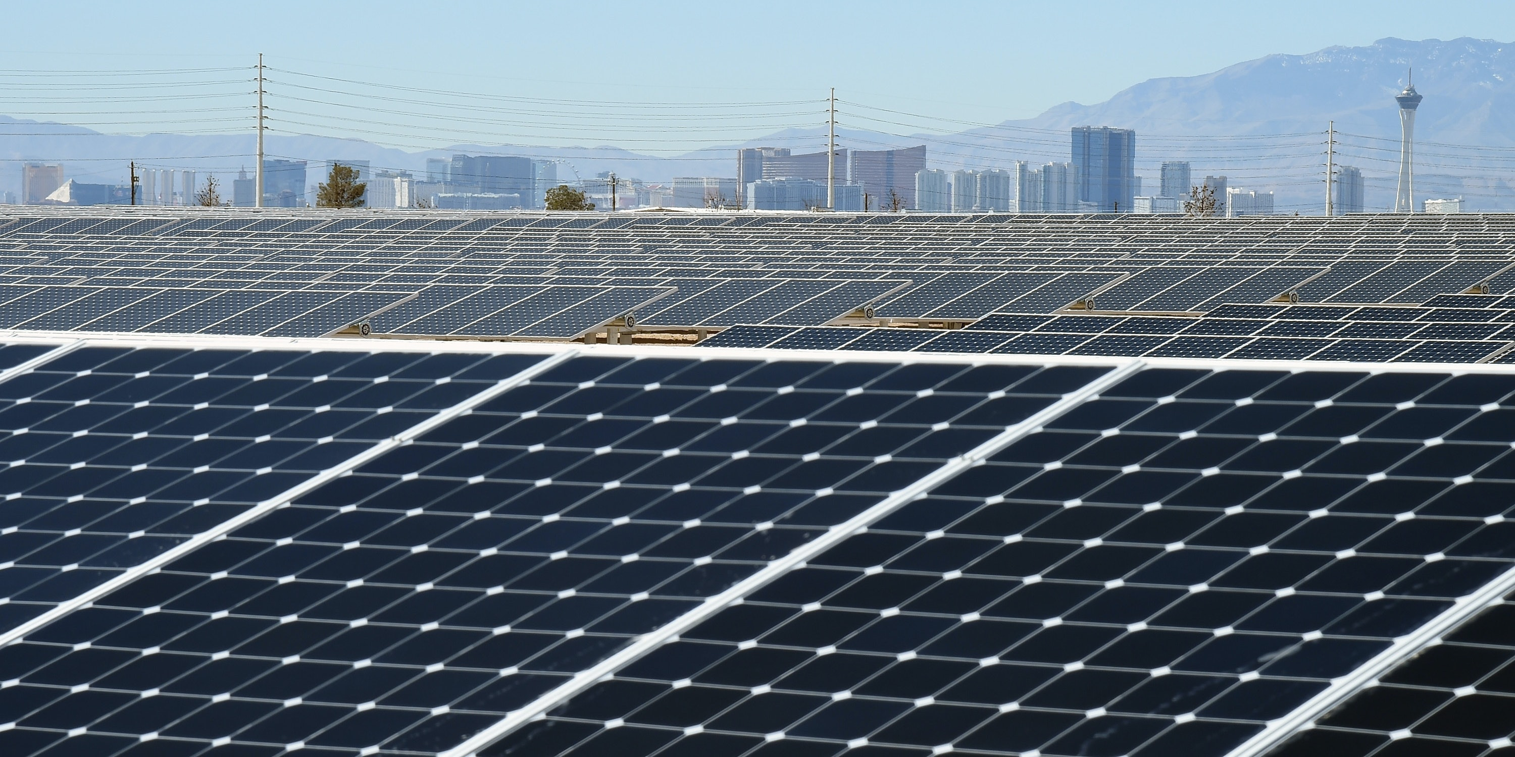 LAS VEGAS, NV - FEBRUARY 16:  The Las Vegas Strip is shown behind solar panels during a dedication ceremony to commemorate the completion of the 102-acre, 15-megawatt Solar Array II Generating Station at Nellis Air Force Base on February 16, 2016 in Las Vegas, Nevada. When coupled with the 13.2-megawatt Nellis Solar Star project completed in 2007, Nellis has the largest solar photovoltaic system in the Department of Defense. During daylight hours the two solar fields combined provide almost all of the base's energy needs or about 42 percent of its overall electricity requirements. Power from the array that is not used will go to the NV Energy grid and back into the local community.  (Photo by Ethan Miller/Getty Images)