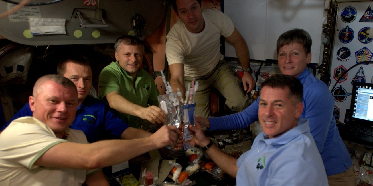 The six Expedition 50 crew members celebrate Thanksgiving in space, Nov. 24, 2016, with rehydrated turkey, stuffing, potatoes and vegetables.