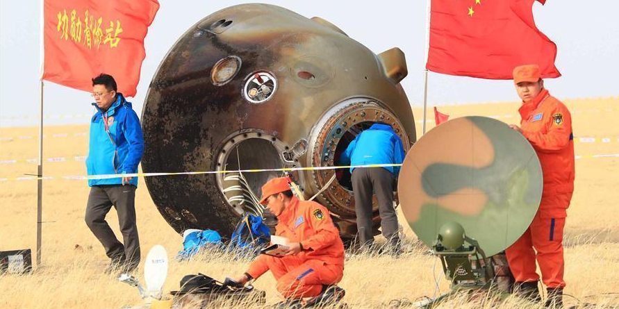 Two Chinese taikonauts returned to Earth safely following a month-long mission.