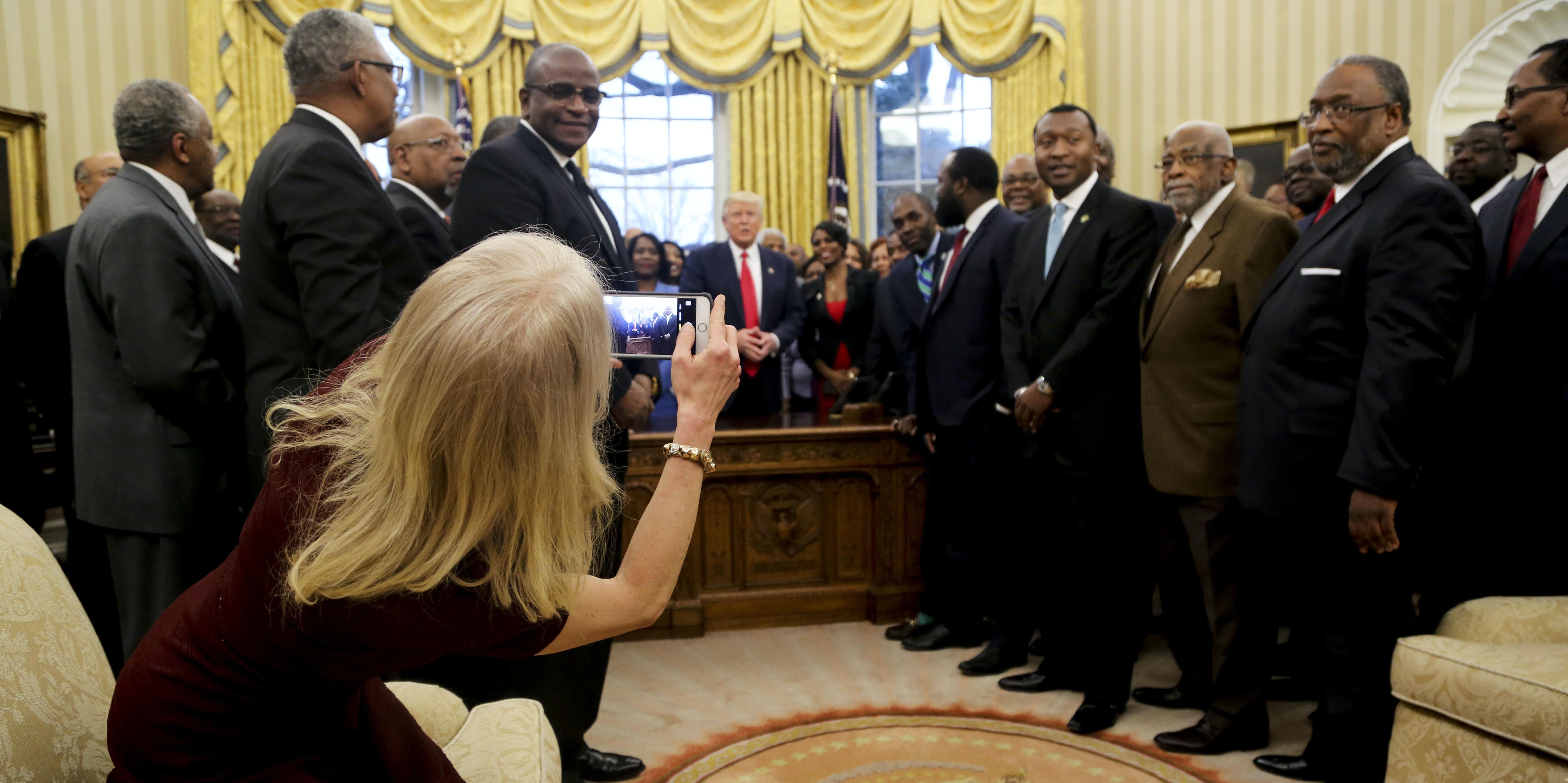 Kellyanne Conway's odd sitting position was memed quickly by the internet.