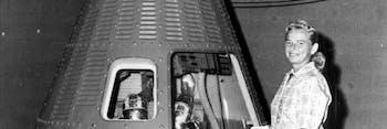 Jerrie Cobb with a Mercury capsule.