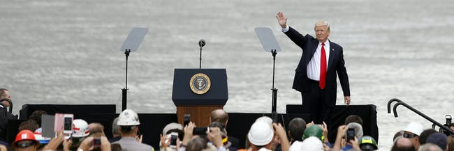 CINCINNATI, OH - JUNE 7: US President Donald Trump waves to the crowd after delivering a speech on June 7, 2017 in Cincinnati, Ohio. Donald Trump spoke about transportation and infrastructure projects. (Photo by Bill Pugliano/Getty Images)