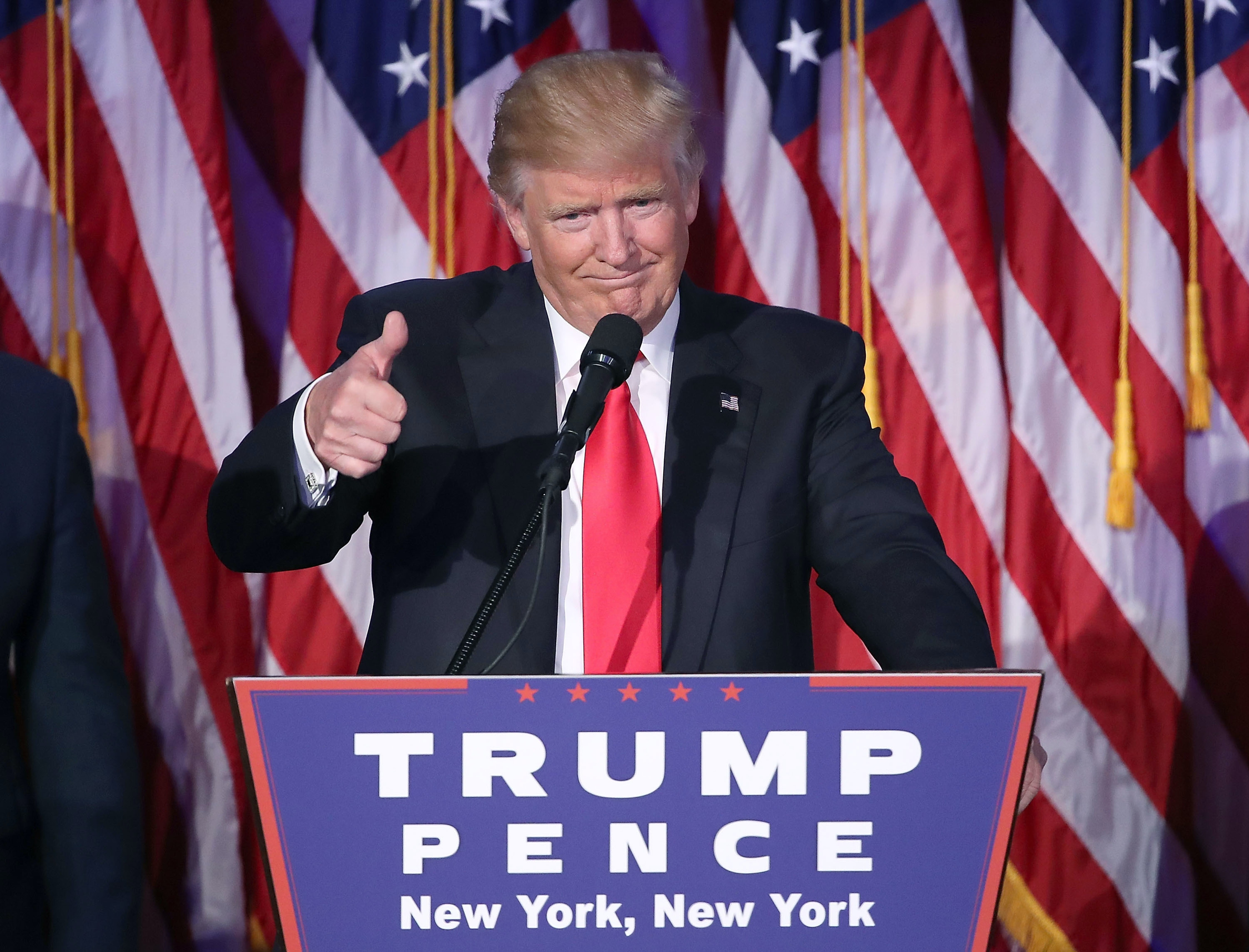 Republican president-elect Donald Trump gives a thumbs up to the crowd during his acceptance speech at his election night event at the New York Hilton Midtown in the early morning hours of November 9, 2016 in New York City.