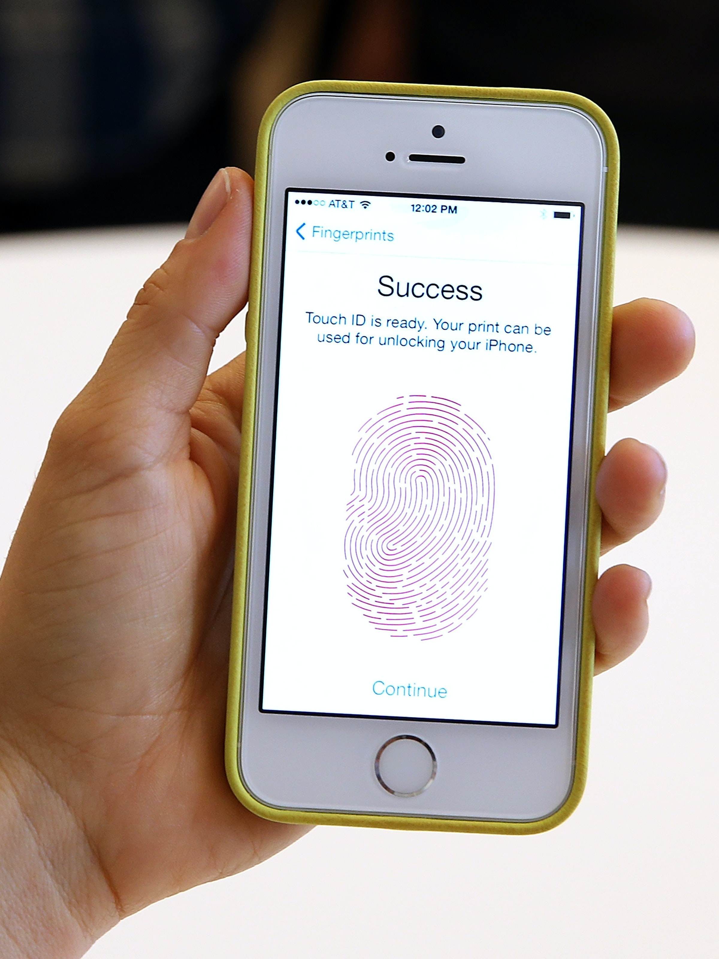 CUPERTINO, CA - SEPTEMBER 10:  The new iPhone 5S with fingerprint technology is displayed during an Apple product announcement at the Apple campus on September 10, 2013 in Cupertino, California. The company launched the new iPhone 5C model that will run iOS 7 is made from hard-coated polycarbonate and comes in various colors and the iPhone 5S that features fingerprint recognition security.  (Photo by Justin Sullivan/Getty Images)