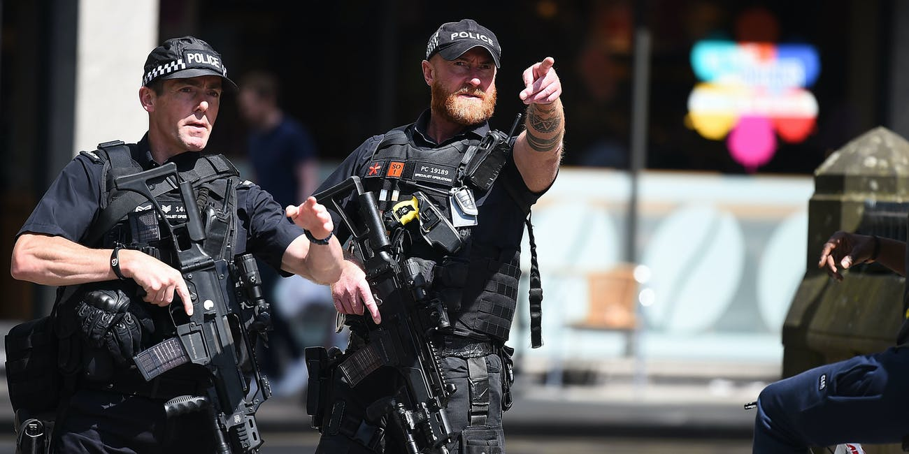 MANCHESTER, ENGLAND - MAY 23: Police stand guard near the Manchester Arena on May 23, 2017 in Manchester, England. At least 22 people were killed in a suicide bombing at an Ariana Grande concert at Manchester Arena which was packed with children. It is the worst terrorist incident on British soil since the London bombings of 2005.