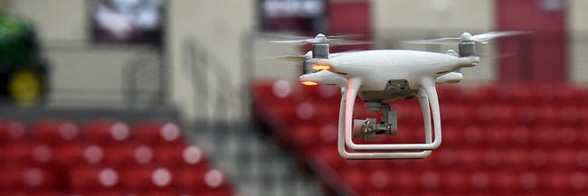A pair of DJI Phantom 4 drones are flown during an AviSight Drone Academy training class at the South Point Hotel & Casino on August 25, 2016 in Las Vegas, Nevada. The Federal Aviation Administration's new Part 107 regulations to operate small unmanned aircraft systems (sUAS) or drones, goes into effect on August 29, 2016. The new rules will allow operators of commercial drones weighing more than .55 pounds and less than 55 pounds to obtain a remote pilot certificate after passing an FAA knowledge exam.