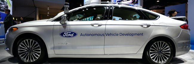 LAS VEGAS, NV - JANUARY 05:  A Ford Fusion hybrid autonomous development vehicle is displayed at the Ford booth at CES 2017 at the Las Vegas Convention Center on January 5, 2017 in Las Vegas, Nevada. CES, the world's largest annual consumer technology trade show, runs through January 8 and features 3,800 exhibitors showing off their latest products and services to more than 165,000 attendees.  (Photo by David Becker/Getty Images)