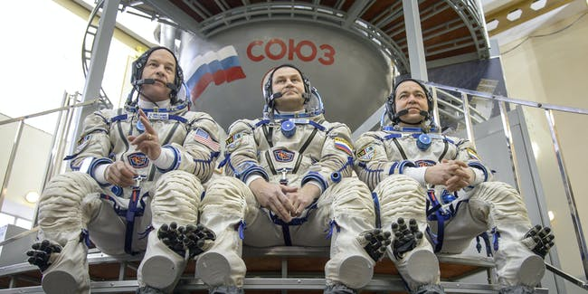 STAR CITY, RUSSIA - FEBRUARY 25:  In this handout provided by NASA,  Expedition 47 crew members: NASA astronaut Jeff Williams, left, Russian cosmonauts Oleg Skripochka, and Alexei Ovchinin of Roscosmos answer questions from the press outside the Soyuz simulator ahead of their final Soyuz qualification exams on February 25, 2016, at the Gagarin Cosmonaut Training Center (GCTC) in Star City, Russia. Photo Credit:  (Photo by NASA/Bill Ingalls via Getty Images)